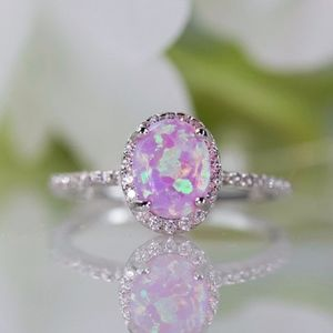 Oval Lab-Created Pink Opal Cabochon Halo Ring